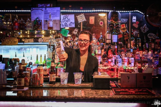 This is a picture of a bartender making cocktails.